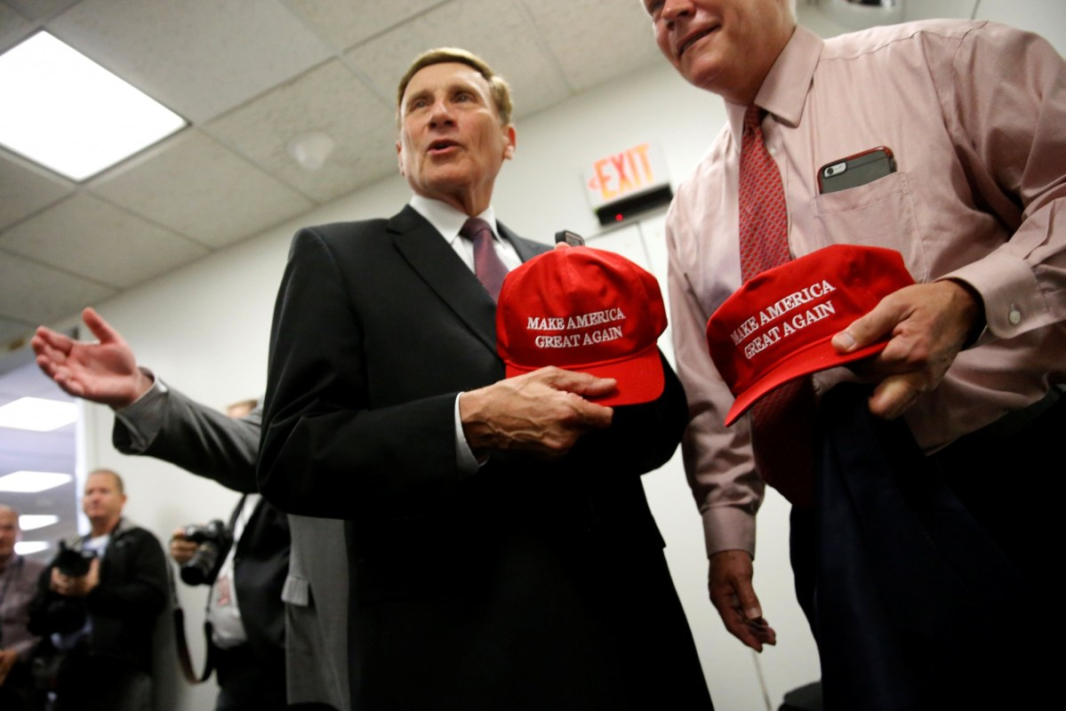 """US Republican representatives John Mica (Florida) and Pete Sessions (Texas) with """"Make America Great Again"""" hats on November 15, 2016. Photo: Reuters/Jonathan Ernst"""