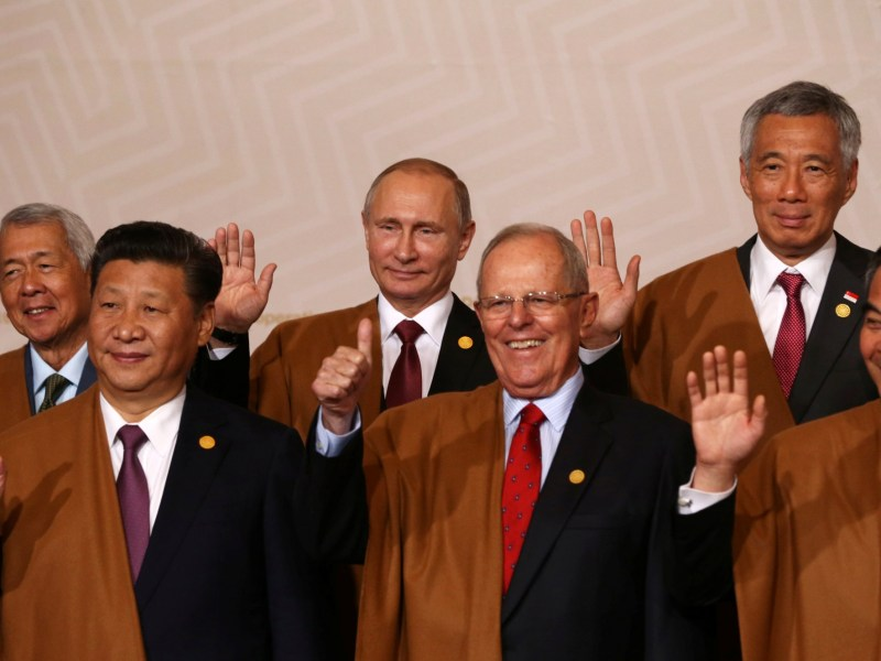 China's President Xi Jinping (Front left) and Hong Kong Chief Executive Leung Chun-ying (Front right) flank Peru's President Pedro Pablo Kuczynski at the Lima APEC summit. Photo: Reuters