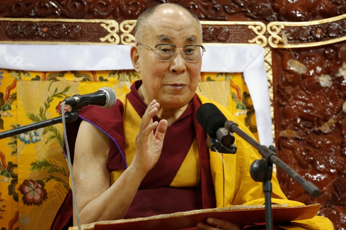 Tibet's exiled spiritual leader the Dalai Lama addresses followers at the Buyant Ukhaa sport palace in Ulaanbaatar, Mongolia. Photo: Reuters/B. Rentsendor