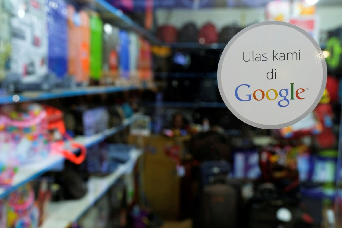 A sticker reading 'Review us on Google' is pictured at smartphone shop in  Jakarta. Photo: Reuters/Beawiharta