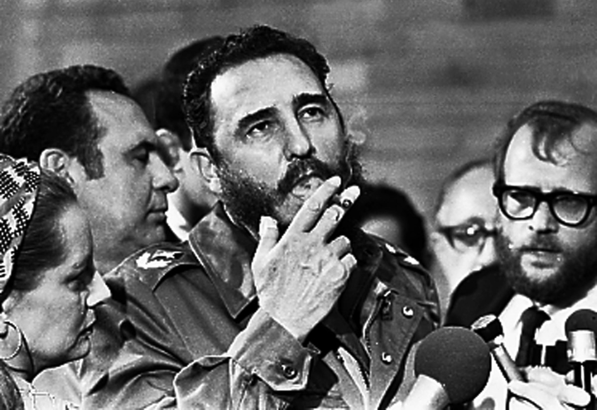 Then Cuban Prime Minister Fidel Castro smokes a cigar during interviews with the press during a visit of US Senator Charles McGovern in Havana in  May 1975. Photo: Reuters/Prensa Latina