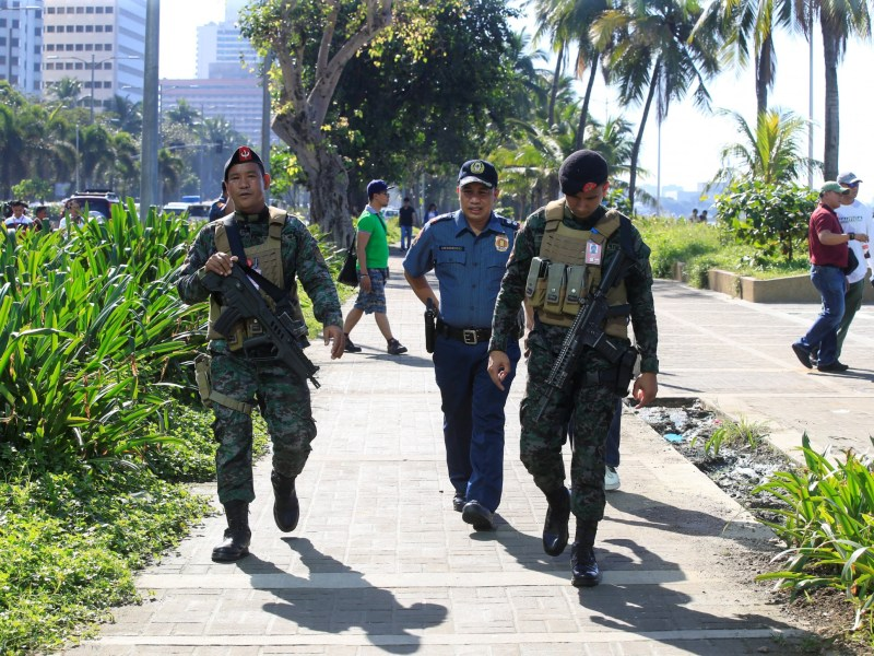 Members of the Philippine National Police Special Action Force patrol after an Improvised Explosive Device (IED) was found near the US Embassy in metro Manila on Monday.  Photo: REUTERS/ Romeo Ranoco