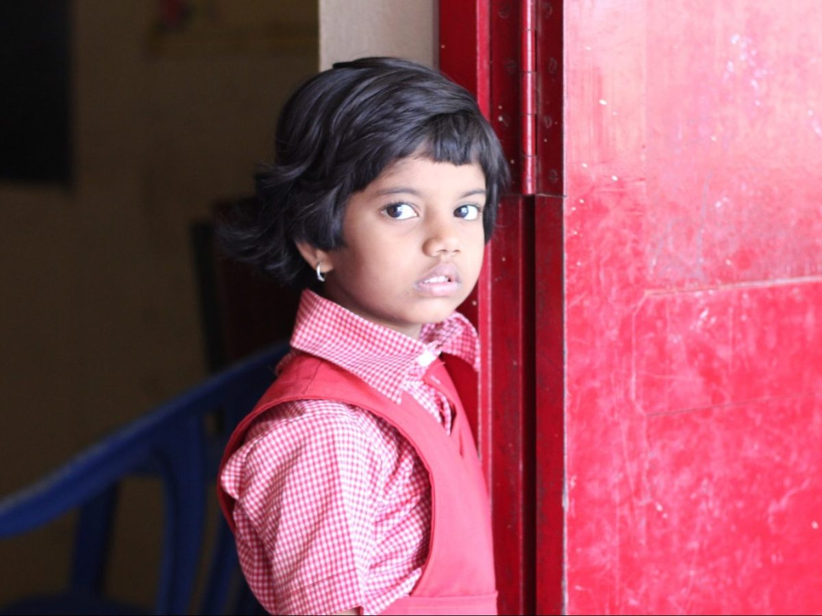 School girl in India [cropped]. Photo: Johan Bichel Lindegaard/Flickr, Creative Commons License: https://creativecommons.org/licenses/by/2.0/legalcode