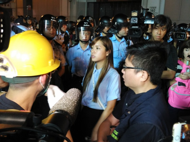 Yau Wai-Ching was in the thick of the protests in Hong Kong on Sunday night outside the Central Government Liaison Office. Photo: Poo Yee Kai