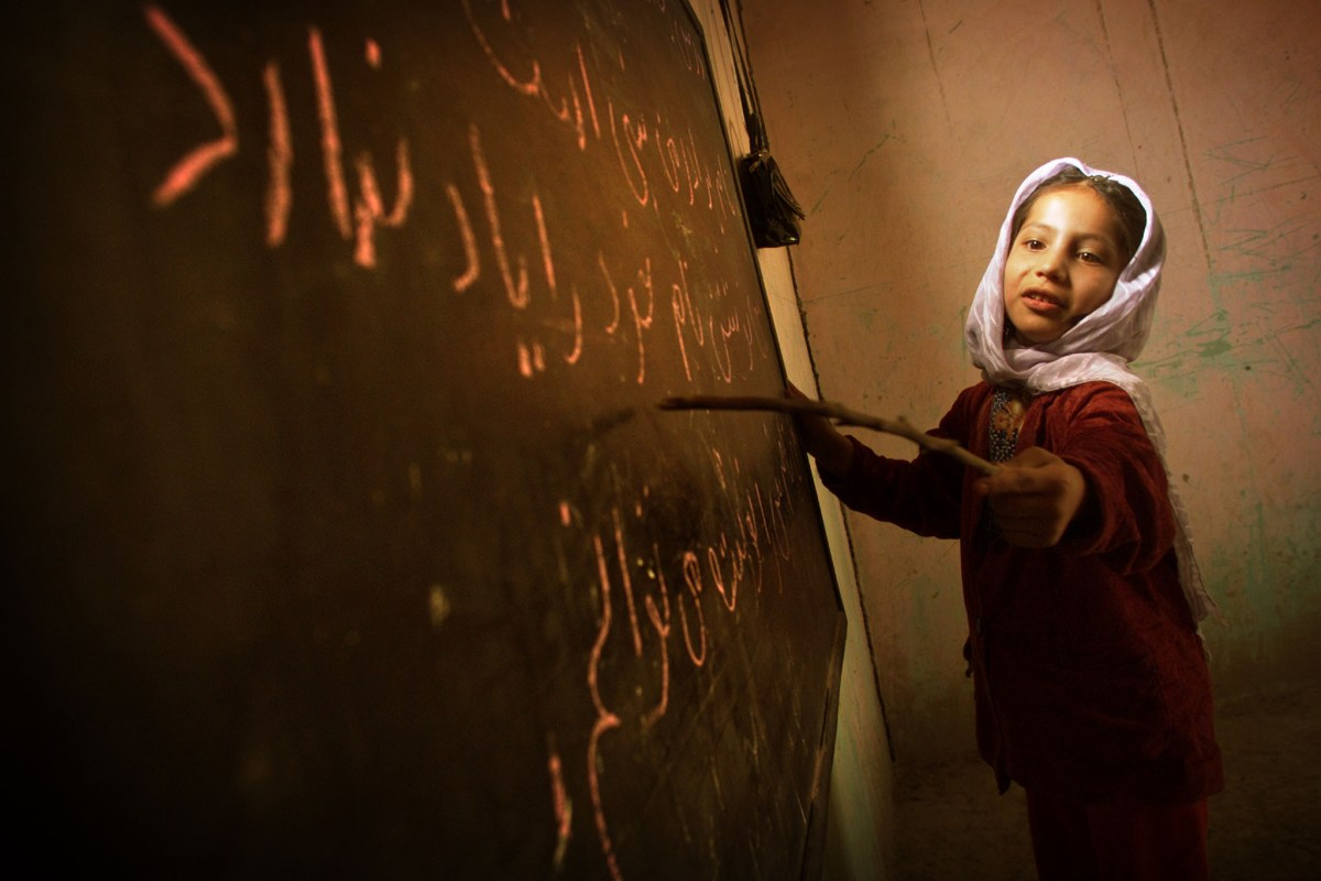 Writing wrongs: children like this Afghan girl are twice as likely to be literate as they were just 25 years ago. Photo: Reuters/Damir Sagolj  DS/GB - RTRQ176