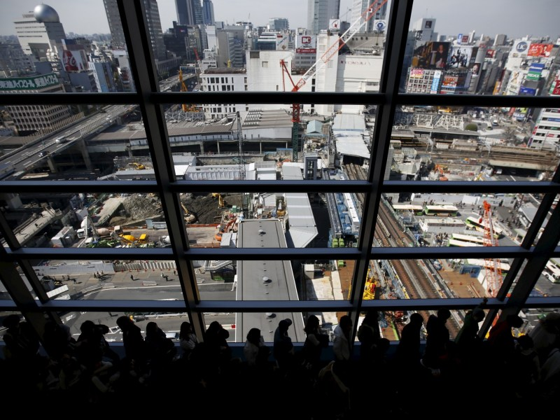 A construction site is viewed through the windows of a high-rise near Shibuya station in Tokyo, Japan. Photo: REUTERS/Issei Kato