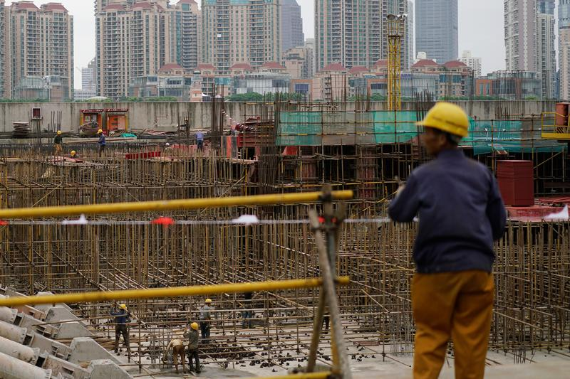 Laborers at a construction site on the Bund in Shanghai. Photo: Reuters/Aly Song
