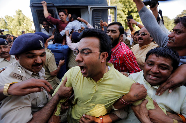 Police detain a supporter of India's main opposition Congress party during a protest against the government's decision to withdraw 500 and 1000 rupee banknotes from circulation, in Ahmedabad. Photo: Reuters/Amit Dave