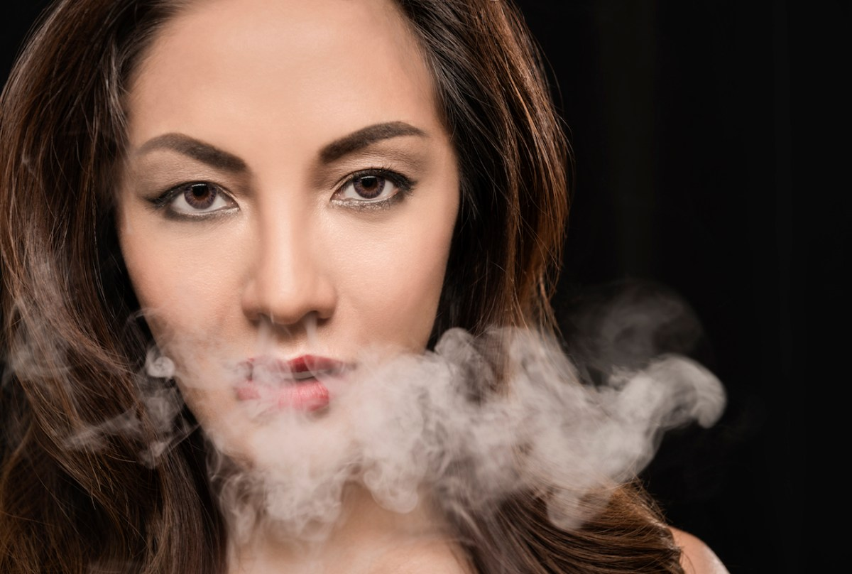 Beautiful woman vaping with smoke. Photo: iStock/Getty Images