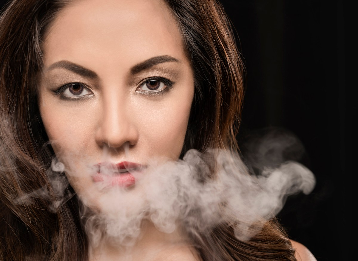 Beautiful woman vaping with smoke. Photo: iStock/Getty Images