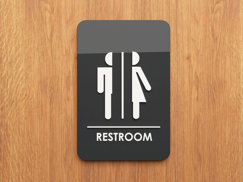 Public restroom sign on the wood 3D design and rendering for your project. Photo: iStock/Getty Images