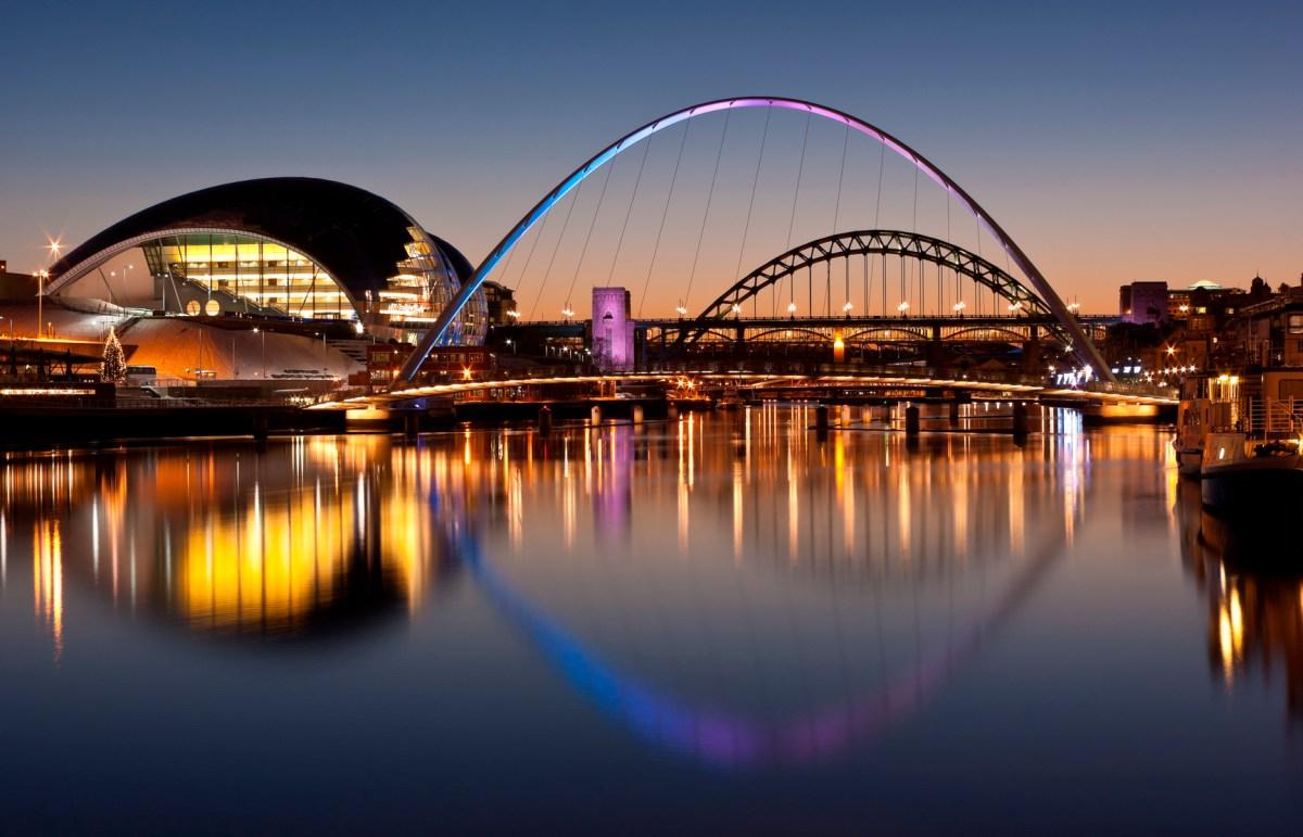 Newcastle and Gateshead at sundown showing Gateshead Millennium Bridge and Tyne Bridges. Photo: iStock/Getty Images