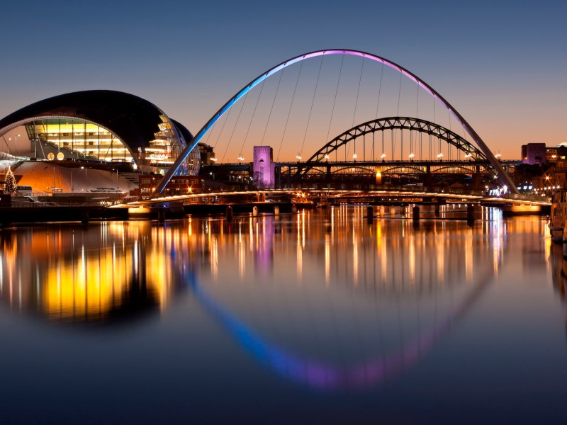 Newcastle and Gateshead at sundown showing Gateshead Millennium Bridge and Tyne Bridges. Photo: iStock/Getty Images