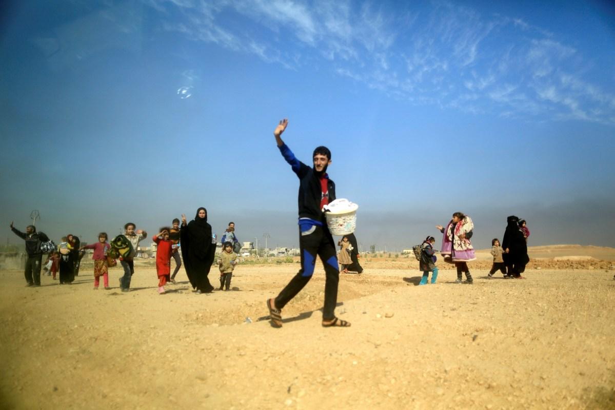 Civilians flee the Iraqi advance into Mosul. Photo: Reuters