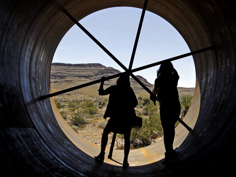 Guests view the inside of a Hyperloop tube at the Hyperloop One Test and Safety site in Las Vegas, Nevada. Photo: John GURZINSKI / AFP