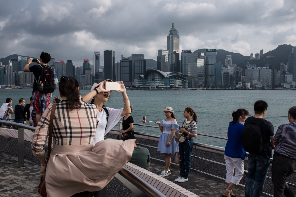 Buying insurance products is a popular way for mainland tourists to Hong Kong to skirt restrictions. Photo: AFP