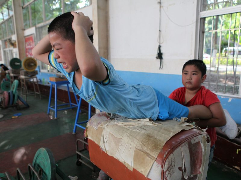 Young Chinese boys train at a weightlifting school in Xiamen, Fujian province.   Photo: AFP