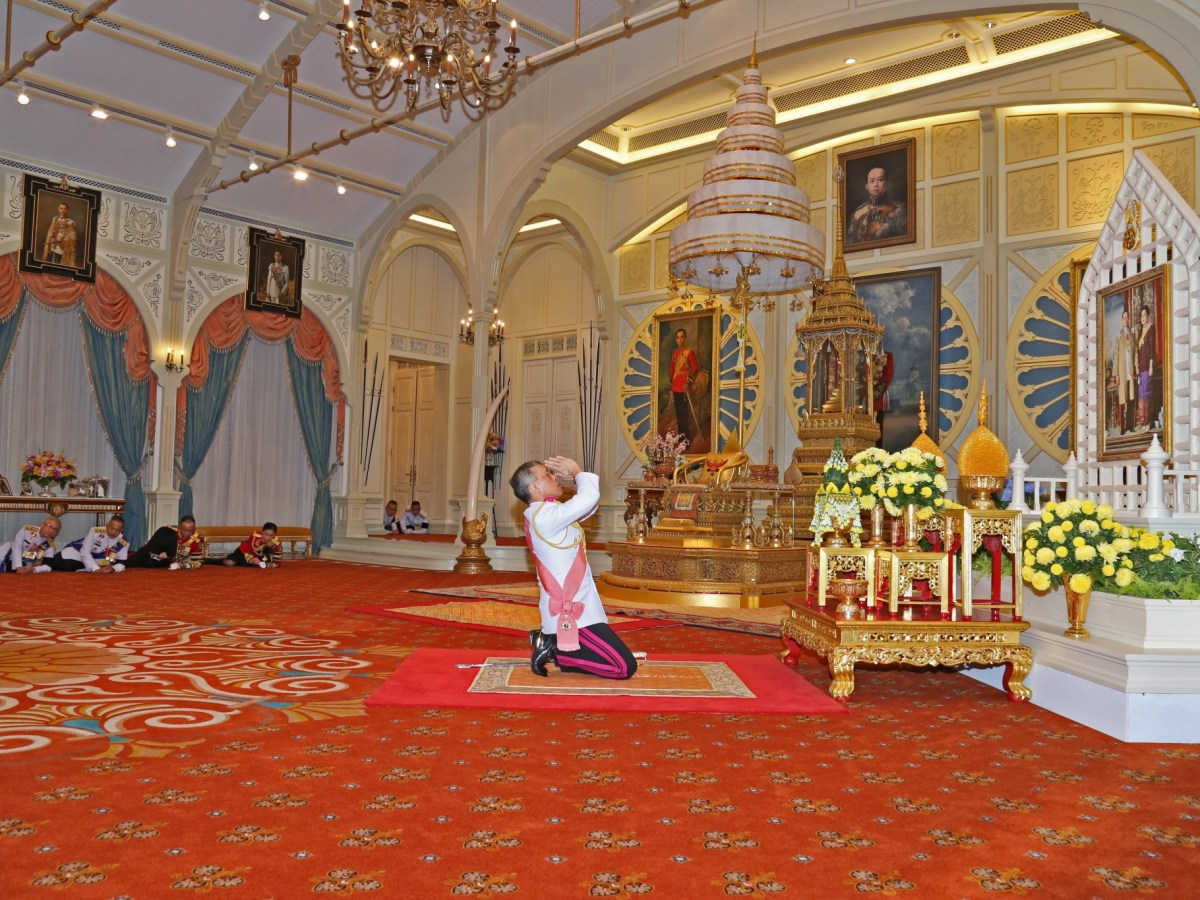 Thai Crown Prince Maha Vajiralongkorn paying respects to his late father King Bhumibol Adulyadej, as he accepted the invitation to ascend to the throne in Bangkok on December 1. Photo: Handout from the Royal Thai Bureau