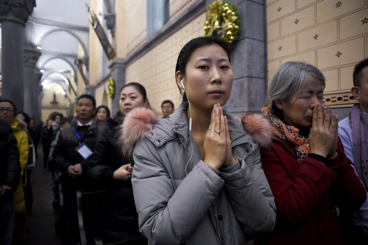 Chinese Christians attend Christmas Eve mass at a Catholic church in Beijing, on December 24, 2016. Photo: AFP / Wang Zhao