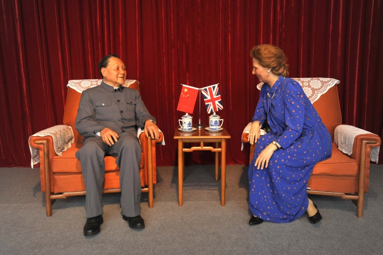 One of the exhibits, wax figures of China's Leader Deng Xiaoping and British Prime Minister Margaret Thatcher. This scene depicts the meeting between Deng Xiaoping and Margaret Thatcher at the Great Hall of the People in Beijing in September 1982 when they discussed the return of Hong Kong to Chinese sovereignty. The figures were produced by Pang Liming and Ai Desheng of the Tianjin Academy of Fine Arts. (Photo courtesy of the Hong Kong Museum of History)