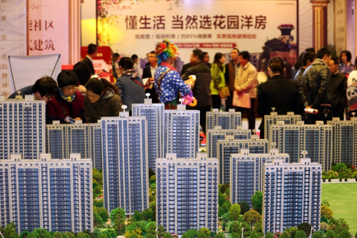 Buyers check out offerings at a residential property display during a real estate fair in Nantong city, east China's Jiangsu province.Photo: AFP