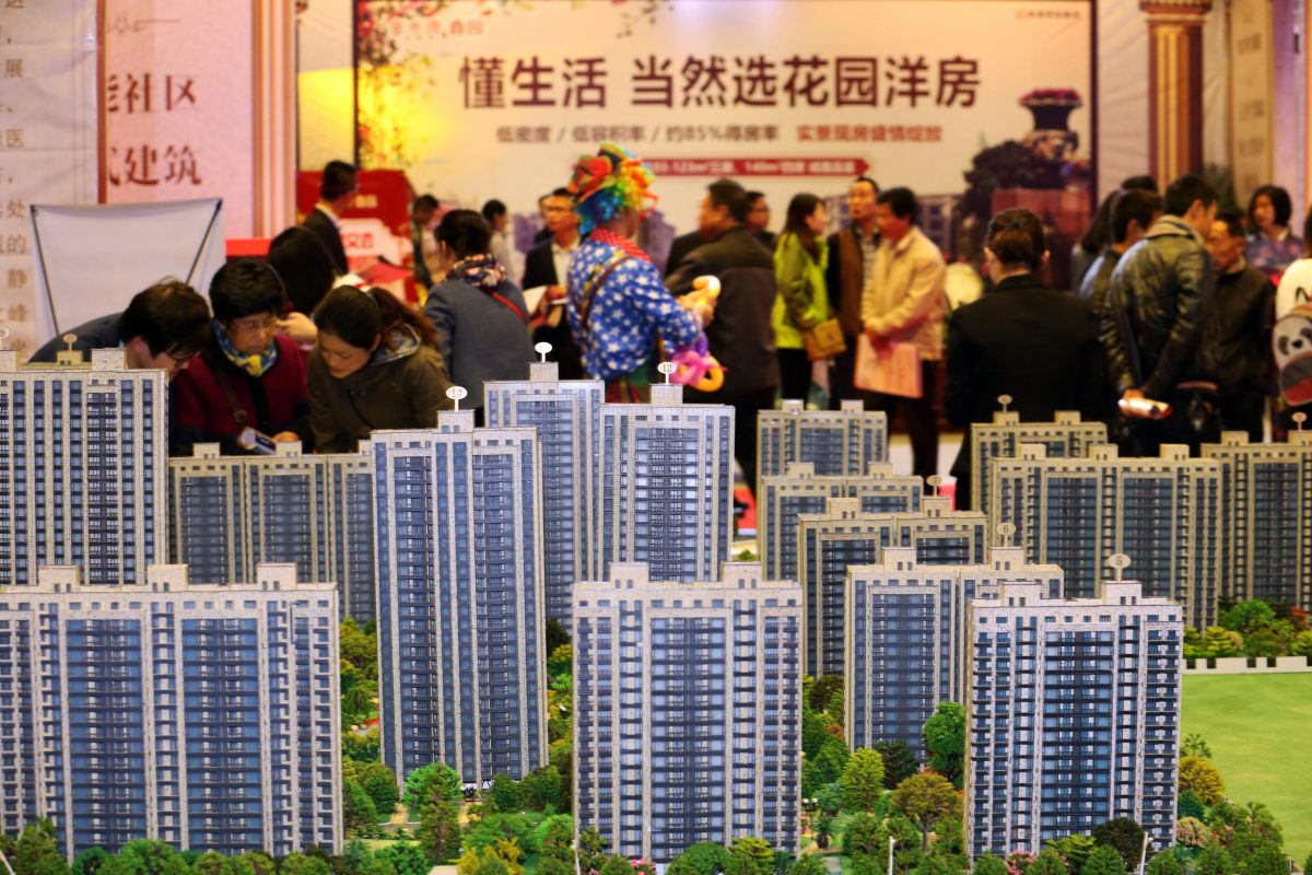 Buyers check out offerings at a residential property display during a real estate fair in Nantong city, east China's Jiangsu province. Photo: AFP