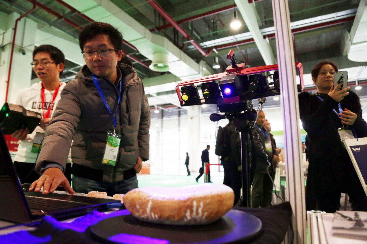 A hand-held monocular 3D scanner is on display during the Inside 3D Printing Conference & Expo in Shanghai, China, 1 December 2016. Photo: AFP