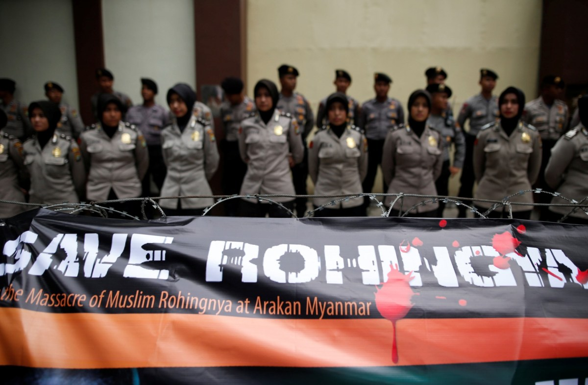 """A banner is tied to barbed-wire outside the Myanmar embassy during a protest against what organisers say is the crackdown on ethnic Rohingya Muslims in Myanmar, in Jakarta, Indonesia November 25, 2016. The text on the poster reads, """"Rohingya are our brothers"""". REUTERS/Darren Whiteside"""