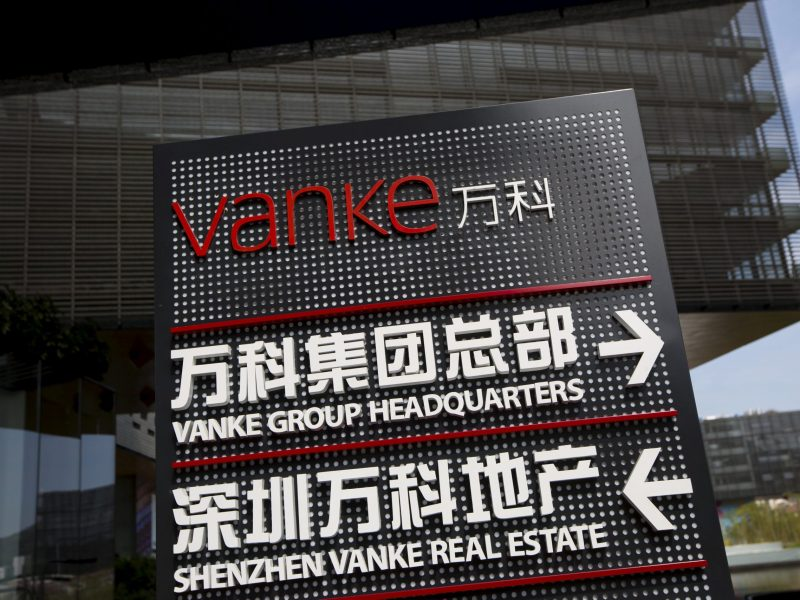 Signs show the direction of Vanke group headquarters and Shenzhen Vanke Real Estate at its headquarters in Shenzhen, south China's Guangdong province, November 2, 2015. REUTERS/Tyrone Siu/File Photo