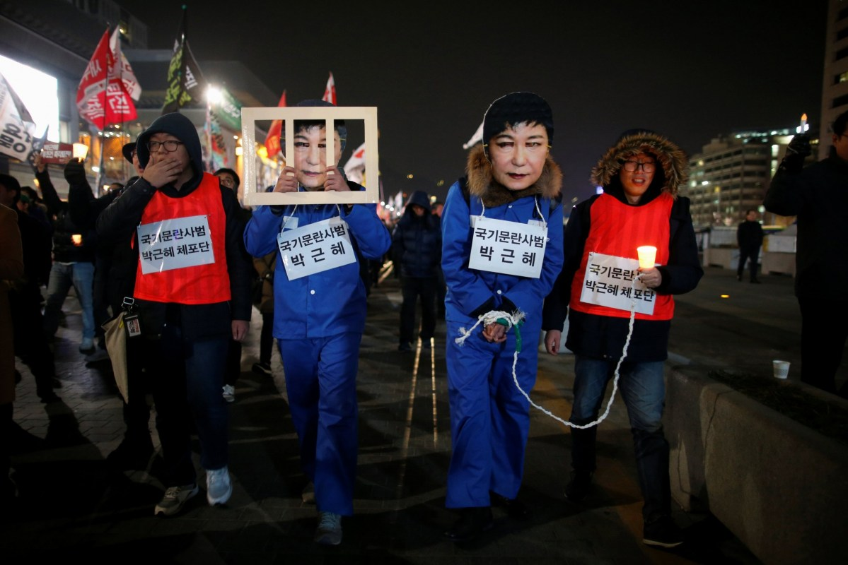 "Protesters calling for South Korean President Park Geun-hye to step down in central Seoul, South Korea, November 30, 2016. The signs read ""Offender disturbing order of nation, Park Geun-hye"". Photo: Reuters/Kim Hong-Ji"