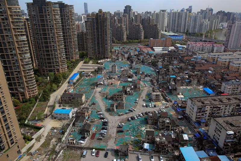 A view of old houses surrounded by new apartment buildings in Guangfuli neighbourhood in Shanghai, China, April 8, 2016. Photo: Reuters / Aly Song