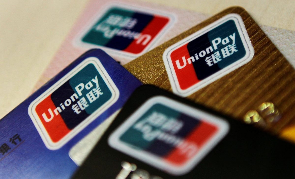 Logos of China UnionPay are seen on bank cards. Photo: Reuters/Barry Huang