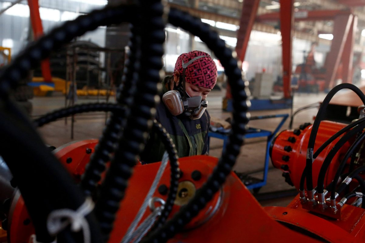 A woman works in the Tianye Tolian Heavy Industry Co. factory in Qinhuangdao, Hebei province. Photo: Reuters/Thomas Peter