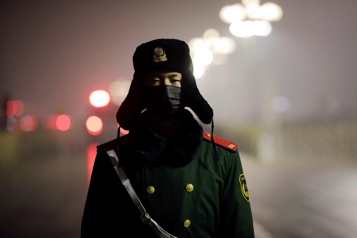 A paramilitary policeman at Tiananmen Square. Photo: Reuters/ Damir Sagolj