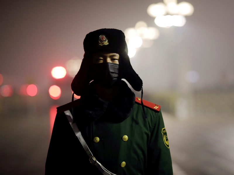 A paramilitary policeman at Tiananmen Square. Photo: Reuters/ Damir Sagolj