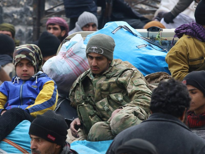 Rebel fighters and civilians gather as they wait to be evacuated from a rebel-held sector of eastern Aleppo, Syria December 16, 2016. Photo: Reuters/Abdalrhman Ismail