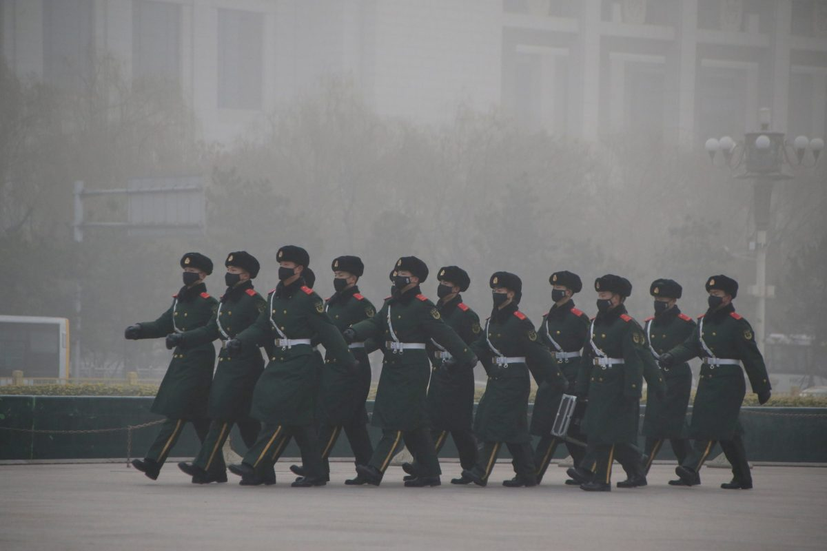 Paramilitary police officers wearing masks patrol in the smog at Tiananmen Square after a red alert was issued for heavy air pollution in Beijing, China, December 20, 2016. Reuters/Jason Lee