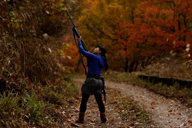 Hunter Masami Hata shoots at a duck in a forest outside Hakusan, Ishikawa Prefecture, Japan, November 20, 2016. Reuters/Thomas Peter