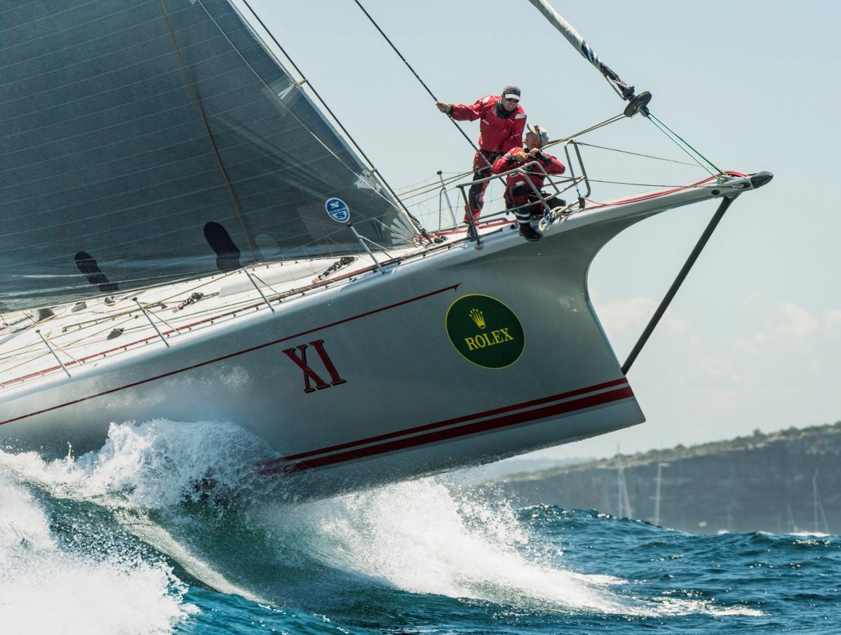 The yacht Wild Oats XI sails out of Sydney Harbour during the start of the annual Sydney to Hobart Yacht race, before withdrawing from Australia's premiere bluewater classic. Photo: Reuters/Rolex