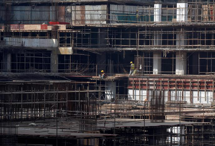 Construction workers work on a site of a residential building in Mumbai. Photo: Reuters/Shailesh Andrade