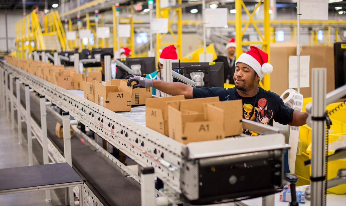 It's hardly Ho! Ho! Ho! at this Amazon Fulfilment Center in the US, but at least they still have jobs. Photo: Reuters/Noah Berger
