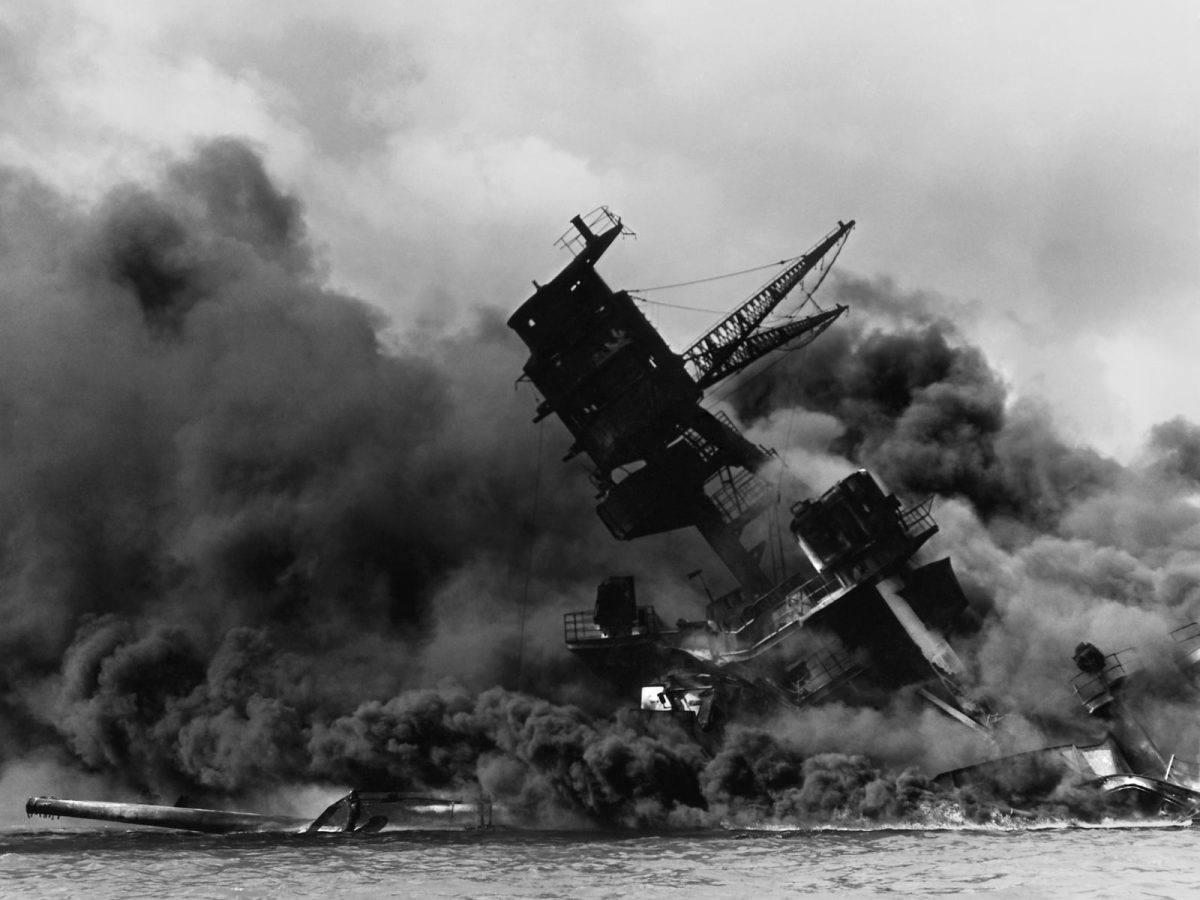 The USS Arizona burns in Pearl Harbor. Photo: Public Domain