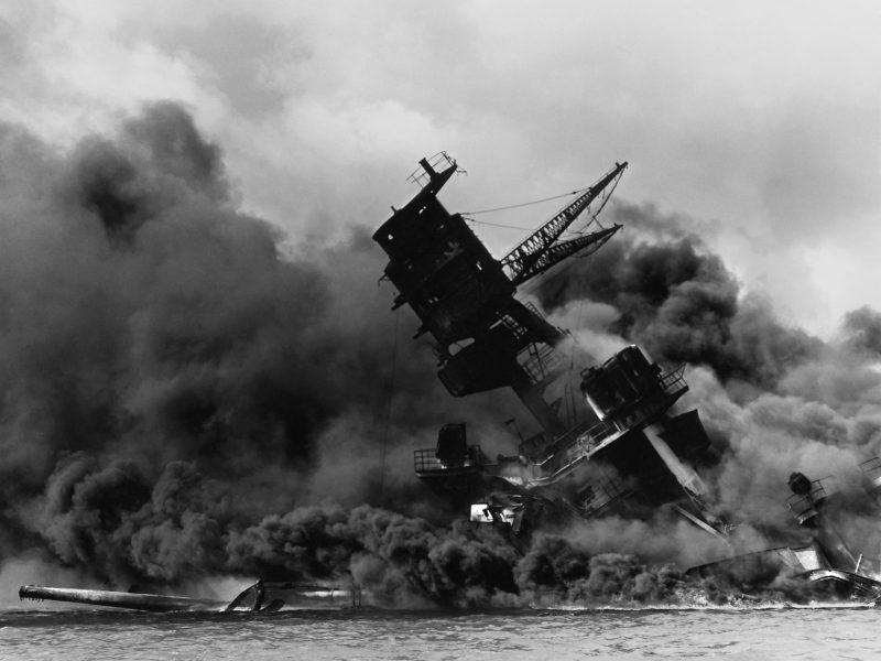 The USS Arizona burns in Pearl Harbor. Photo: Public Domain