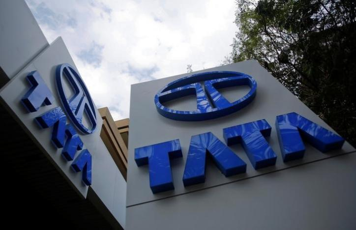 Tata Motors logos are seen at their flagship showroom before the announcement of their Q3 results in Mumbai February 14, 2013.  REUTERS/Vivek Prakash/Files