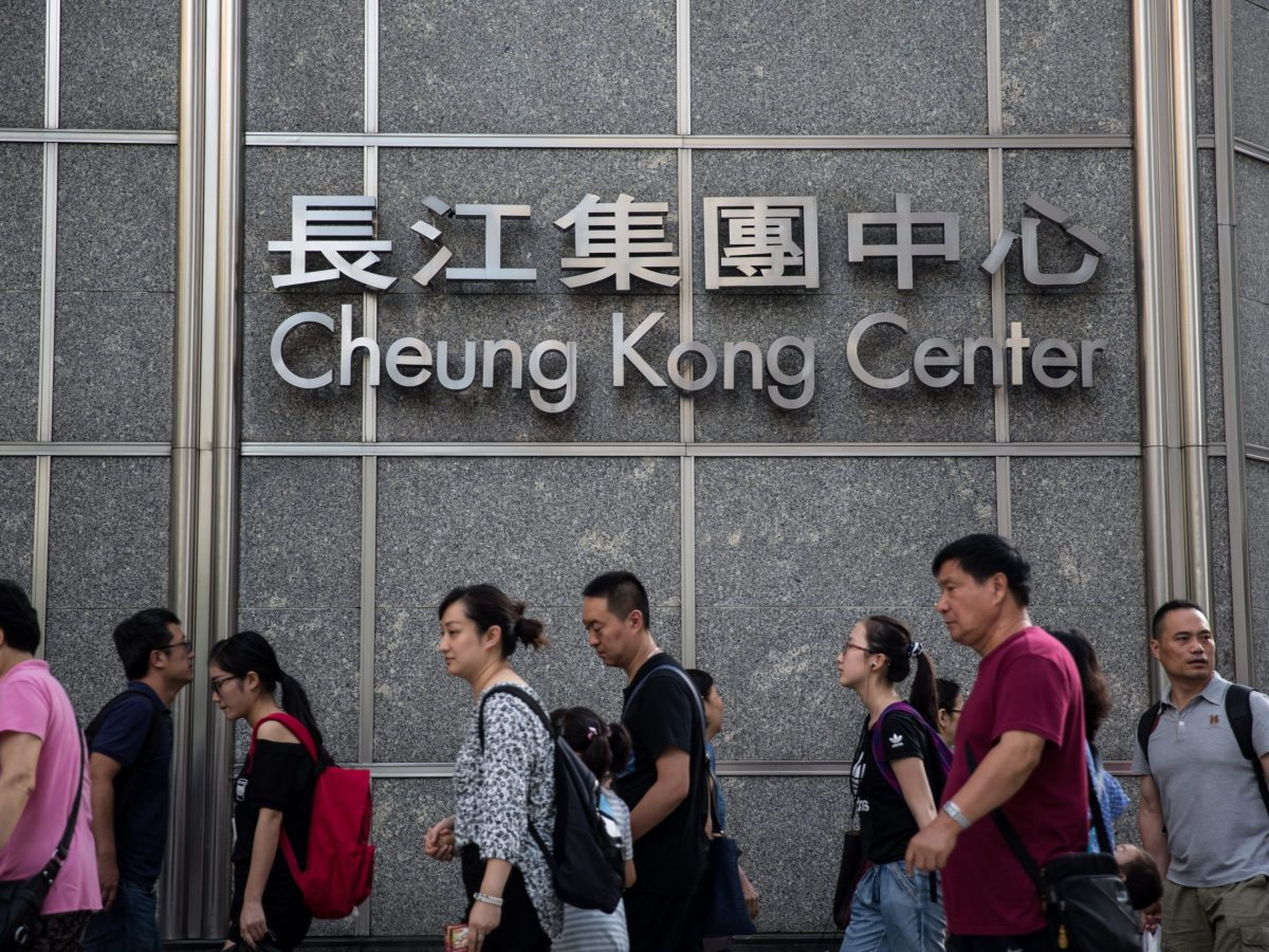 Pedestrians walk past the Cheung Kong Center in Hong Kong. Photo: AFP/Anthony Wallace