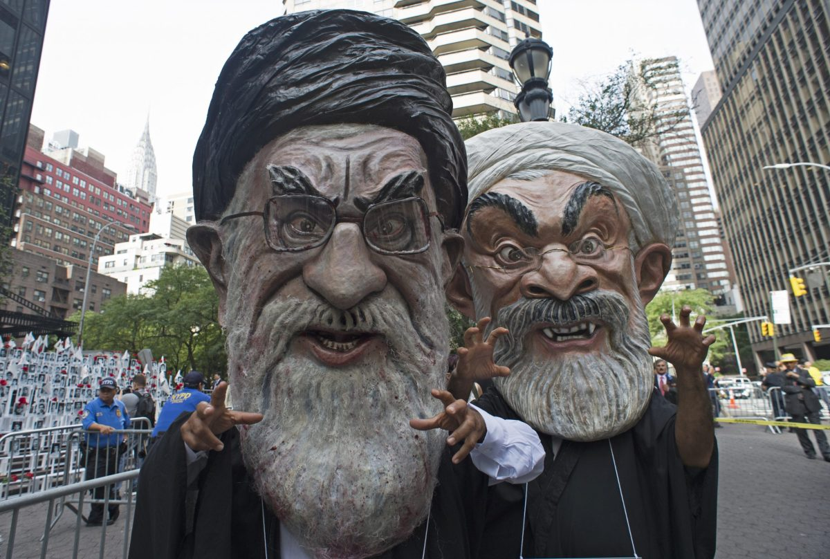 Iranian Americans in Ali Khamenei (left) and Hasan Rouhani masks rally against the regime near the United Nations building in New York on September 20, 2016. Photo: AFP / Don Emmert
