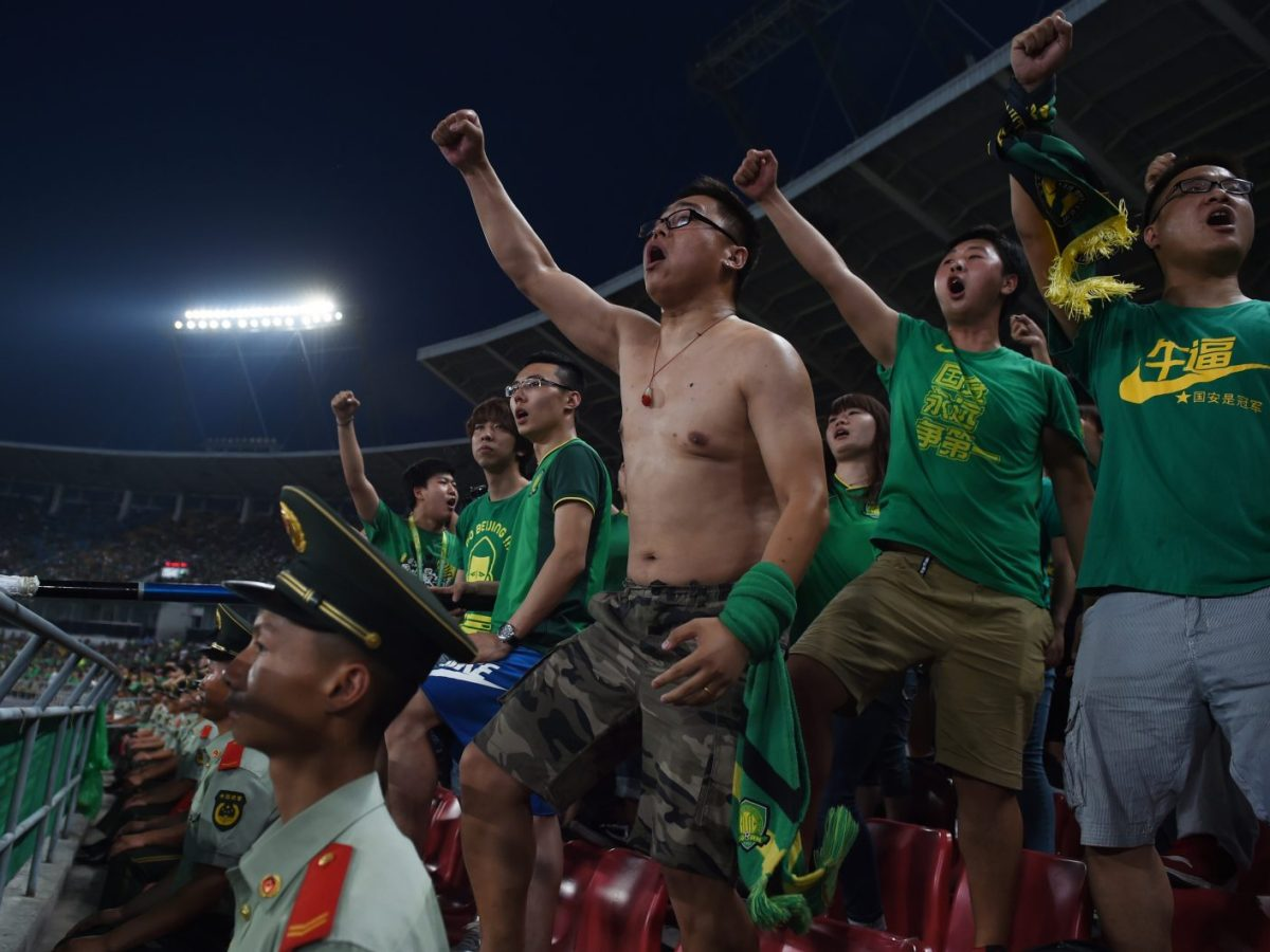 Fans of Beijing Guoan show their support, and some flesh. Photo: AFP / Greg Baker