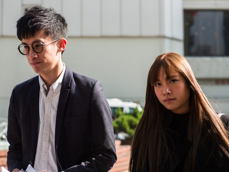Pro-independence former lawmakers Baggio Leung (L) and Yau Wai-ching (R) arrive to speak to the press outside the High Court in Hong Kong on November 30, 2016. Photo: AFP/Anthony Wallace