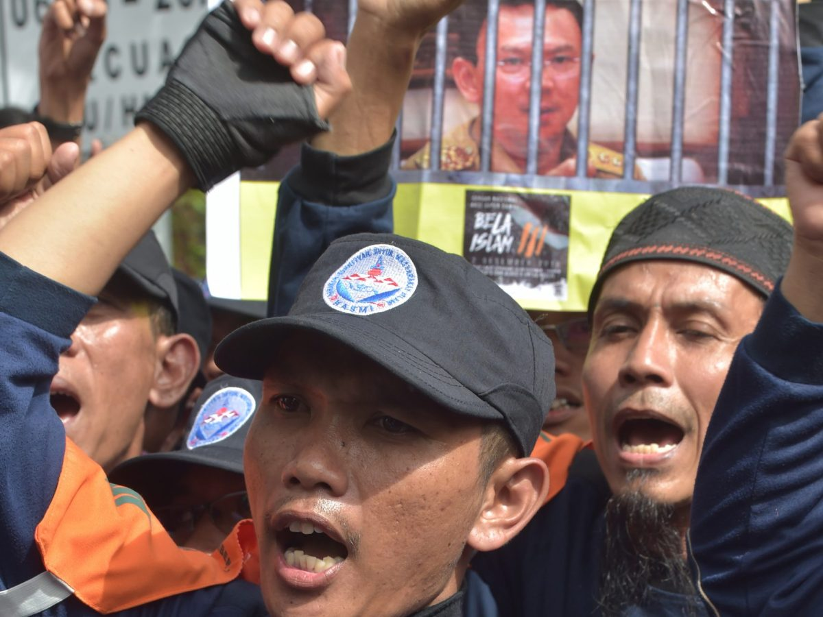 Indonesian Muslim demonstrators attend a protest against Jakarta's Christian governor Basuki Tjahaja Purnama outside the North Jakarta court as he stands trial for blasphemy in Jakarta on December 13, 2016. The case has stoked fears of growing intolerance in the Muslim-majority nation. Photo: AFP/ Adek Berry