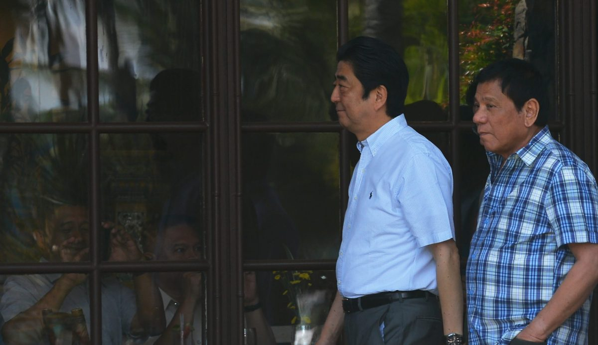 Japanese Prime Minister Shinzo Abe (left) walks with Philippine President Rodrigo Duterte (right)  in Davao City on January 13, 2017. Photo: AFP / Ted Aljibe